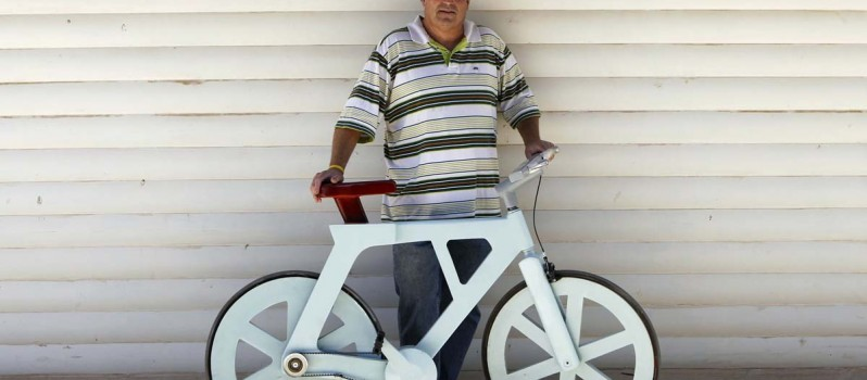 Israeli inventor Izhar Gafni poses for a photo with his cardboard bicycle in Ahituv