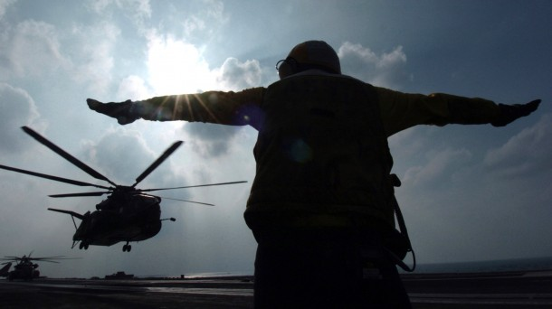 US serviceman signals helicopter at the Gulf south of Iraq