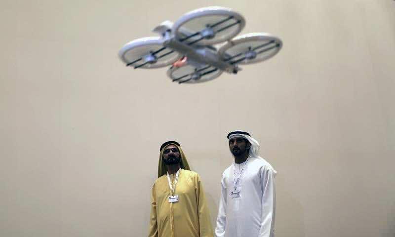 United Arab Emirates' Prime Minister and Ruler of Dubai Sheikh Mohammed bin Rashid al-Maktoum and his son Dubai's Crown Prince Sheikh Hamdan bin Mohammed al-Maktoum watch an unmanned aerial drone during Virtual Future Exhibition, in Dubai