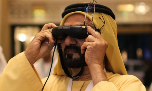 United Arab Emirates' Prime Minister and Ruler of Dubai Sheikh Mohammed bin Rashid al-Maktoum looks through a visor as he tests an unmanned aerial drone during Virtual Future Exhibition, in Dubai