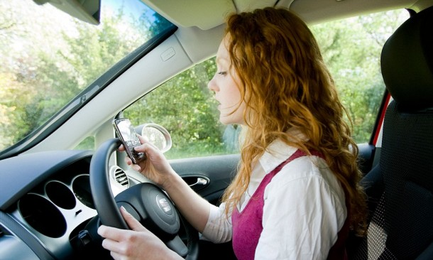Girl texting whilst driving