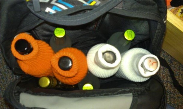 2. Use tube socks to protect your bottles in transit
