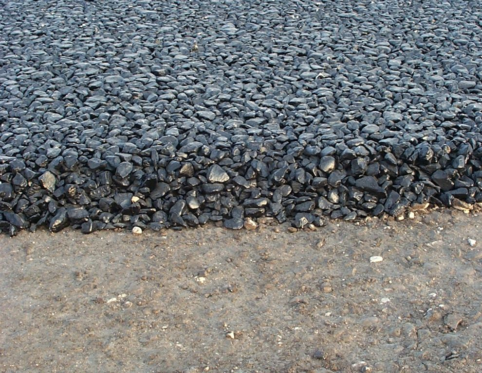 What is asphalt Base for concrete driveway