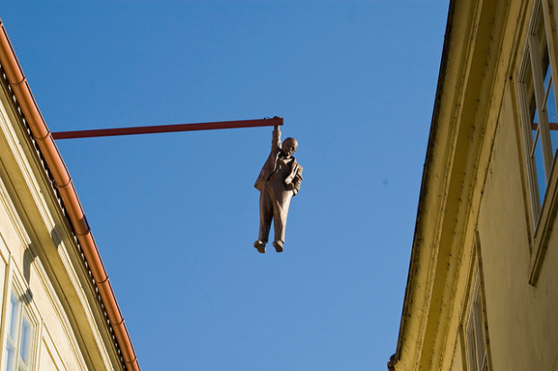 man-hanging-out-sculpture