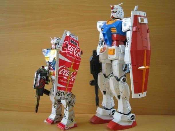 4.) Gundam robot made from cans next to an actual Gundam robot action figure.