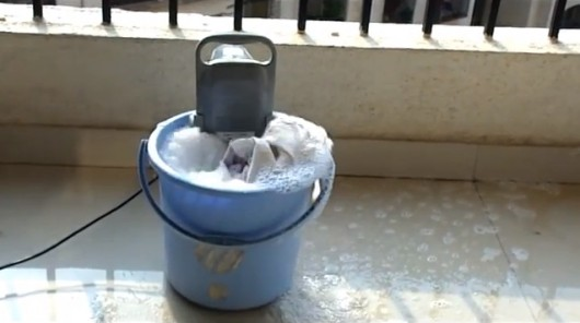 This Gadget Converts Any Bucket Into A Washing Machine