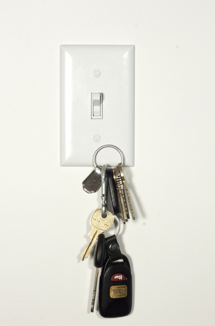 11. A magnetic light switch cover