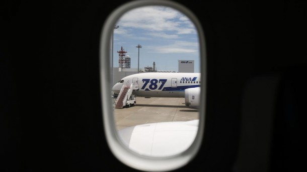 An ANA's Boeing 787-8 Dreamliner airplane is seen through a window of a Boeing 787-9 Dreamliner during a media preview at Haneda airport in Tokyo