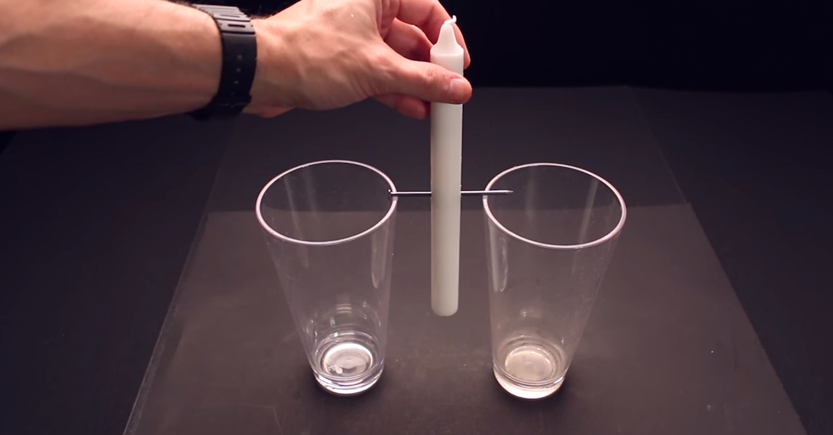 Candle between 2 glasses