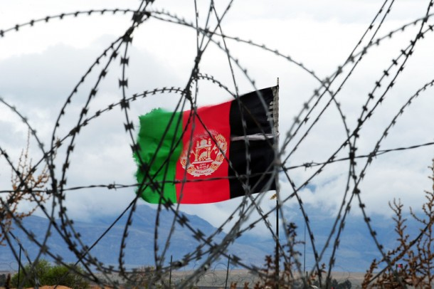 In this picture taken on March 17, 2014, the Afghan national flag flutters in the wind behind barbed wire at a forward operating base where soldiers attached to the 4th Brigade, 201 Army Corps of the Afghan National Army (ANA) live in Khogyani district. In the eastern district of Khogyani, the war against Taliban militants is a day-to-day struggle for control of fields and villages just outside Jalalabad, one of Afghanistan's biggest and most strategic cities. ROBERTO SCHMIDT/AFP/Getty Images