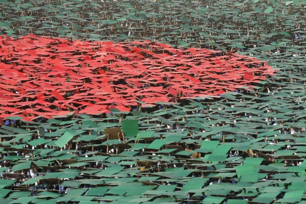 Volunteers prepare to form a large flag of Bangladesh as the nation celebrates National Victory Day at the National Parade ground in Dhaka December 16, 2013. According to the organizers, 27,117 volunteers formed a large human national flag for six minutes and sixteen seconds as they attempted to set a new Guinness world record. Bangladesh won independence from Pakistan on December 16, 1971, following a nine-month guerrilla war which cost millions of lives. REUTERS/Andrew Biraj (BANGLADESH - Tags: POLITICS ANNIVERSARY SOCIETY TPX IMAGES OF THE DAY) ORG XMIT: DHA006