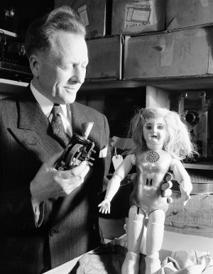 Collecter, Ward Harris, holds a talking doll with a metal torso that was invented by Thomas Edison, in San Francisco, Calif., Feb. 9, 1949. Harris holds in his other hand the inside mechanicals of the doll of which there is a wheel that contains phonograph impressions. Sound comes out of he cone at top of the doll and through holes below its neck. Edison gave the doll to the daughter of an expressman in Orange, N.J. when she was ill. It is one of only two dolls that are known to exist. The other doll is in the Henry Ford collection. (AP Photo/Ernest K. Bennett)