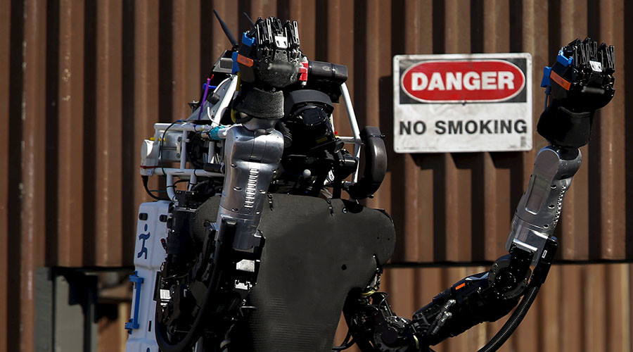 """The Team IHMC Robotics Atlas """"Running Man"""" robot built by Boston Dynamics raises its arms to celebrate after climbing the stairs during the finals of the Defense Advanced Research Projects Agency (DARPA) Robotic Challenge in Pomona, California"""