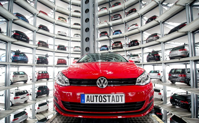 epa04943428 (FILE) A file photo dated 14 March 2013 shows a Volkswagen Golf VII being picked by an automatic elevator to be transported out of the glass silo, which is used as storage for new VW cars in the Autostadt (Autocity) in Wolfsburg, Germany. German carmaker Volkswagen on 21 September 2015 issues a profit warning for the third quarter in the wake of the scandal surrounding manipulated exhaust tests in the US. Some 11 million cars worldwide are affected by the emissions-cheating software, Volkswagen said. EPA/SEBASTIAN KAHNERT