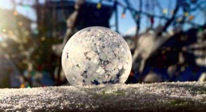 Bubble frozen into ice sphere