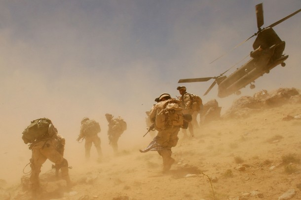 A CH-47 Chinook helicopter takes off after dropping soldiers in Bagh village of Khakeran Valley, Zabul province, Afghanistan, Sunday, June 26, 2005. A U.S. CH-47 Chinook transport helicopter, carrying 15 to 20 people, crashed Tuesday, June 28 while ferrying reinforcements to fight insurgents in a mountainous region in eastern Afghanistan. The Taliban claimed to have shot down the aircraft. (AP Photo/Tomas Munita)