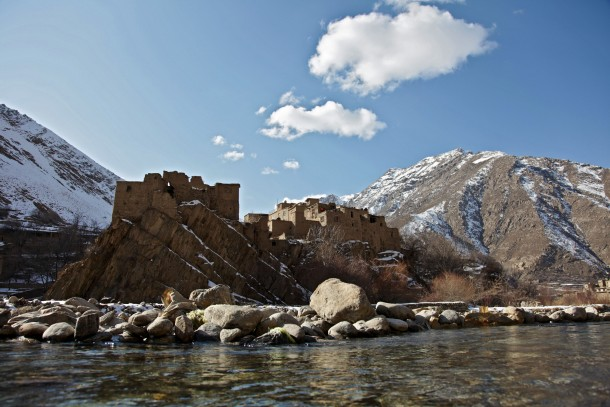 A group of houses sit over a rocky foundation across the river in the Dara District of Panjshir Province, Afghanistan, Jan. 3, 2010. (U.S. Army photo by Sgt. Teddy Wade/Released)