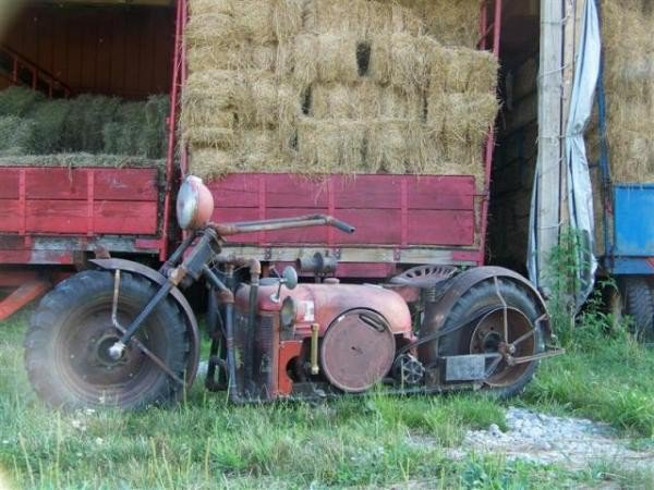 guy makes cycle from tractor parts2
