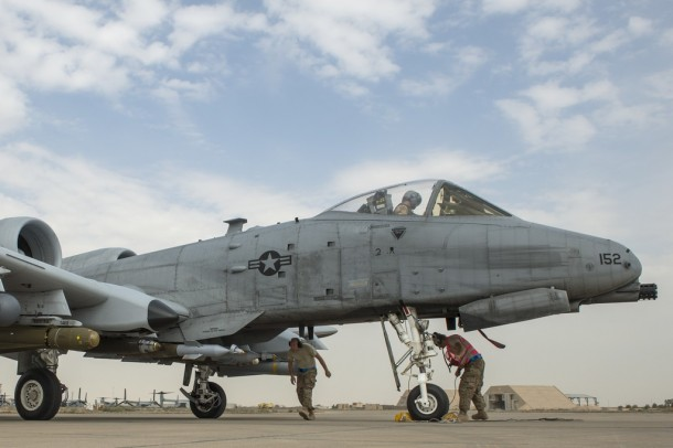 U.S. Air Force Airmen arm weapon systems on an A-10 Thunderbolt II prior to a mission supporting Operation Inherent Resolve in Southwest Asia, Jan. 31, 2015. (U.S. Air Force photo by Senior Airman James Richardson/AFCENT/Released)