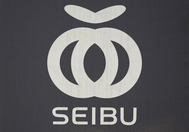 A logo of Seibu Railway Co., railway service unit of Seibu Holdings, is seen on the train coach at a station in Tokyo June 25, 2013. REUTERS/Issei Kato