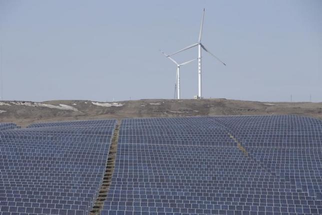File picture of wind turbines and solar panels at a wind and solar energy storage and transmission power station from State Grid Corporation of China, in Zhangjiakou of Hebei province