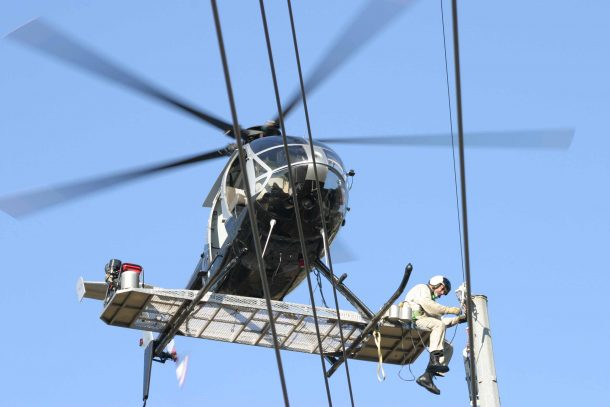 Inspecting Power Lines perched on the outside of a Flying Helicopter Might Be the Most Hazardous Job_Image 1