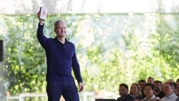Apple CEO Tim Cook holding up what Apple say is the billionth iPhone sold. Credits: Apple News
