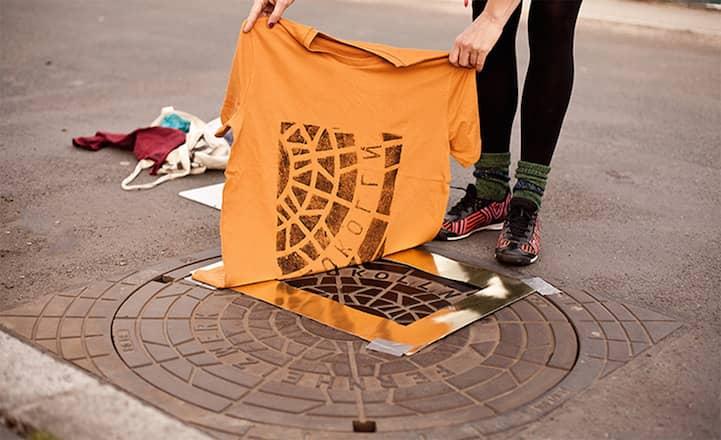 'Pirate Printers' Use Manhole Covers To Print Urban Style Custom T-Shirt Designs_Image 0