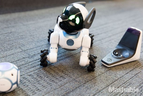 WowWee CHiP ships with a charging base (right) and a SmartBall (left). Credits: Mashable