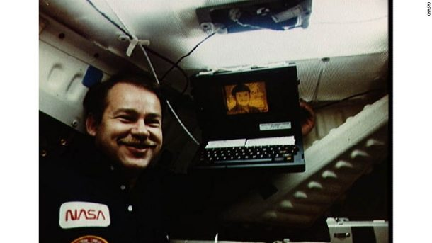 NASA astronaut John Creighton poses with a Grid laptop in a 1985 photo. Credits: NASA
