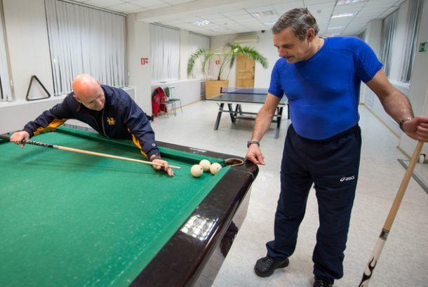 In this Thursday, March 19, 2015 photo provided by NASA, astronaut Scott Kelly, left, plays pool with Russian cosmonaut Mikhail Kornienko, of the Russian Federal Space Agency (Roscosmos), at the Cosmonaut Hotel in Baikonur, Kazakhstan. On Friday, March 28, 2015, Kelly and Kornienko will travel to the International Space Station to begin a year-long mission living in orbit. (AP Photo/NASA, Bill Ingalls)