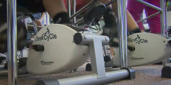 teacher-installs-cycling-machines-under-the-students-desks-to-help-them-concentrate_image-1
