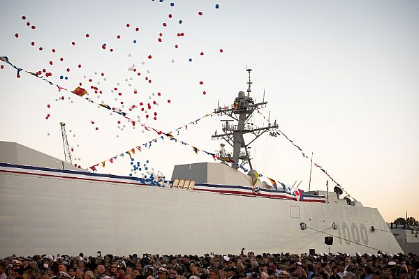 161016-N-AT895-183 BALTIMORE, (Oct. 16, 2016) Balloons fly and the crowd applauds as the Navy's newest and most technologically advanced warship, USS Zumwalt (DDG 1000), is brought to life during a commissioning ceremony at North Locust Point in Baltimore. (U.S. Navy photo by Petty Officer 1st Class Nathan Laird/Released)
