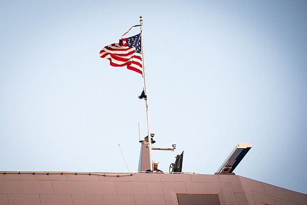 161016-N-AT895-158 BALTIMORE (Oct. 16, 2016) The national ensign and commissioning penant fly over the Navy's newest and most technologically advanced warship, USS Zumwalt (DDG 1000). (U.S. Navy photo by Petty Officer 1st Class Nathan Laird/Released)