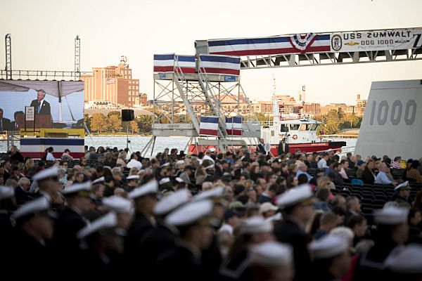 161015-N-AT895-136 BALTIMORE (Oct. 16, 2016) The iconic Brewer's Hill neighborhood of Baltimore can be seen in the background as Secretary of the Navy (SECNAV) Ray Mabus delivers remarks during the commissioning ceremony for the Navy's newest and most technologically advanced warship, USS Zumwalt (DDG 1000). (U.S. Navy photo by Petty Officer 1st Class Nathan Laird/Released)