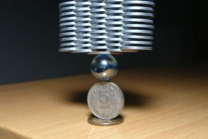 This Amateur Japanese Artist Makes Incredible Gravity Defying Coin Structures