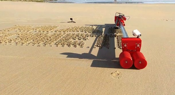 robotic printer that writes on sand
