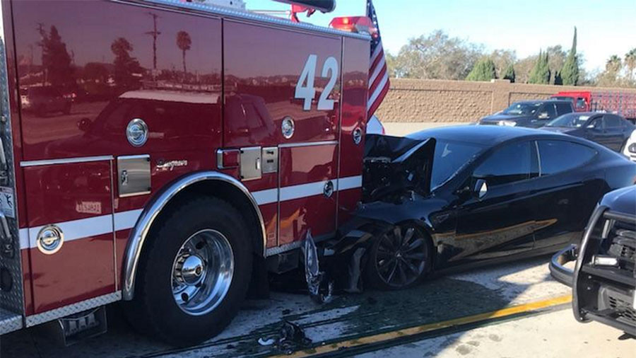 tesla accident with parked fire truck