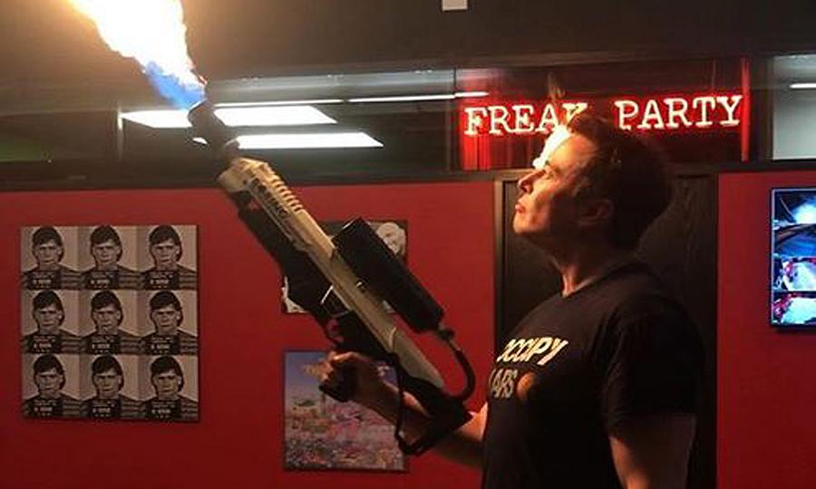 elon musk and joe regan with the boring company flamethrower