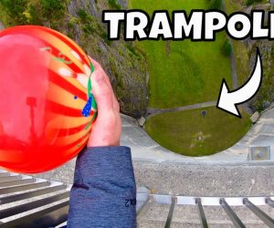 bowling ball dropped on trampoline from the top pf a dam
