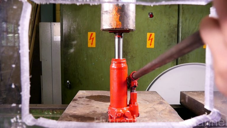 car jacls crushed by hydraulic press