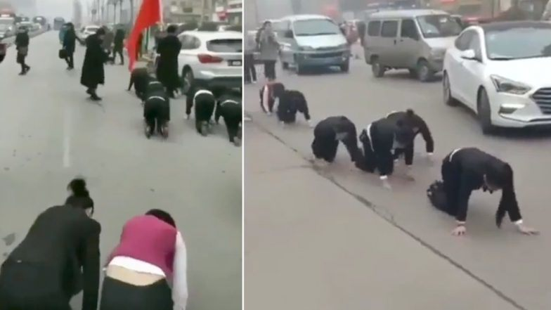 Employees Forced To Crawl Streets As Punishment!